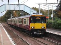 318 250 stands at the northbound platform at Blantyre on 13 October 2007 with a train for Milngavie.<br><br>[David Panton&nbsp;13/10/2007]