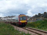 On the new Alloa line 170476 passes Waterside LC heading for Stirling and Glasgow Queen Street.<br><br>[Brian Forbes&nbsp;/08/2008]