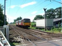 A Morecambe to Leeds service on its short WCML dash to the junction at Carnforth passes Bolton-le-Sands crossing, which is CCTV controlled from Hest Bank signal box. View south towards Hest Bank. <br><br>[Mark Bartlett&nbsp;07/08/2008]