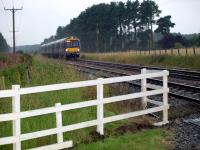 Edinburgh to Dundee class 170 unit heading north passing Sweetholm Crossing in a downpour.<br><br>[Brian Forbes&nbsp;09/08/2008]