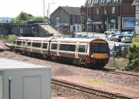 The 12.18 Glasgow Queen Street - Alloa service pulls away from the Larbert stop on 3 July 2008. <br><br>[John Furnevel&nbsp;03/07/2008]