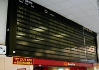 The <I>spotty</I> electro-magnetic departure board at Dundee on 31 July 2008. Possibly time for an upgrade.<br><br>[David Panton&nbsp;31/07/2008]