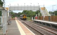 A Carlisle - Glasgow Central train arriving at Gretna Green on 11 August 2008 with the new down platform now operational. Work still to be completed at the recently extended station includes installation of permanent lighting and the fitting of ramps to the footbridge.<br><br>[John Furnevel&nbsp;11/08/2008]