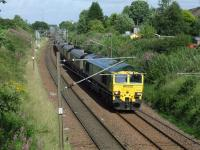 66605 with a train of empty coal hoppers from Leeds bound for Hunterston on 16th July<br><br>[Graham Morgan&nbsp;16/07/2008]