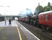An ECS movement in connection with the <I>15 Guinea special</I> railtour, with 48151 and 70013, together with their support coaches, heading south from Carnforth destined for an overnight stop in Manchester. The train is seen passing south through Leyland on 9 August 2008.<br> <br><br>[John McIntyre&nbsp;09/08/2008]