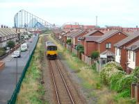 150133 leaves Squires Gate and heads towards that distinctive skyline on a service for Blackpool South on 13 August. This view shows how the modern housing development has encroached towards what was once a busy mainline. <br><br>[Mark Bartlett&nbsp;13/08/2008]
