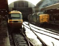 Twas Christmas Eve 1981, train 1S12 05.50 Kings Cross-Aberdeen prepares to leave Newcastle Central behind York Deltic 55017 <I>The Durham Light Infantry</I>. With one week left in service 55017 still looks every inch the Gateshead locomotive she once was, i.e. filthy dirty.<br><br>[Colin Alexander&nbsp;24/12/1981]