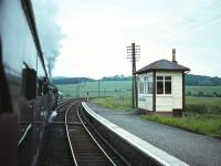 Eastbound on <I>The Port Road</I> through New Galloway towards Dumfries in the early 1960s. In common with a number of other stations on the Dumfries - Stranraer line the link between the station name and the actual location was often <I>tenuous</I> to say the least. In this case the location is the village of Mossdale, a considerable distance from the <I>New Galloway</I> shown on the station nameboard. Closure came in 1965.  <br><br>[Robin Barbour Collection (Courtesy Bruce McCartney)&nbsp;//]