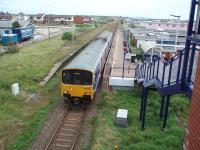 Squires Gate, serving Blackpool Airport and the nearby Starr Gate tram terminus, opened in 1931. It was something of an eyesore for many years but has now been tidied up. View towards St. Annes as 150133 departs towards Blackpool South. <br><br>[Mark Bartlett&nbsp;13/08/2008]