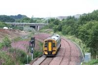 View west towards Livingston as an Edinburgh - Bathgate service passes the site of the former Bangour Junction on 18 August 2008.<br><br>[James Young&nbsp;18/08/2008]