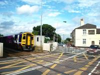 158759 hurries eastwards through Hospital Crossing on a Blackpool to York service. The crossing is next to a busy road junction and is not automatic but controlled and monitored from Bamber Bridge signal box. It is a cramped location for photographers though.  <br><br>[Mark Bartlett&nbsp;16/08/2008]