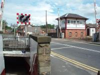 The L&Y signal box at Parbold, which still controls a mixture of semaphores and colour light signals protecting the block section and the level crossing. The subway under the line can also be seen in this view in August 2008. <br><br>[Mark Bartlett&nbsp;13/08/2008]