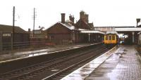 A cold, wet Wednesday afternoon at Sleaford station in February 1974, as a DMU prepares to leave on a service to Nottingham.<br><br>[Ian Dinmore&nbsp;03/02/1974]