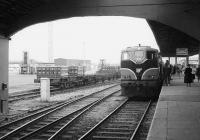 View out from the trainshed at Tralee in 1988 with CIE 085 standing at the head of a recent arrival on platform 1. <br><br>[Bill Roberton&nbsp;//1988]