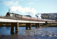 Standard class 5 no 73146 brings the 10am Dundee - Glasgow Buchanan Street train over the Tay at Perth in 1965. The locomotive was one of the batch fitted with Caprotti valve gear and allocated to St Rollox shed.<br><br>[Robin Barbour Collection (Courtesy Bruce McCartney)&nbsp;29/10/1965]
