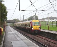 334 012 with a Glasgow Central - Largs service calls at Milliken Park on 20 August.<br><br>[David Panton&nbsp;20/08/2008]