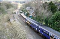 An afternoon Northern Rail service from Middlesbrough to Whitby runs into Sleights on 3 April 2008. The main station buildings on the retained down platform, including the station masters house, are now part of a substantial private residence, while the former wooden <I>waiting shed</I> and store from the abandoned up platform, having been rescued by the NYMR, now adorn the down side at Grosmont station. The old brick signal box on the left beyond the foot crossing (leading to a footbridge over the River Esk off to the left) is gradually returning to nature.<br><br>[John Furnevel&nbsp;03/04/2008]