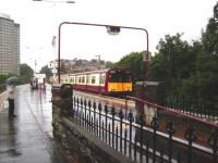 A Cathcart Inner Circle service formed by 314 211 calls at Pollokshaws East on 20 August.<br><br>[David Panton&nbsp;20/08/2008]
