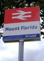 New station signage at north entrance to Mount Florida station in August 2008. This is part of the agreement (including the new Saltire livery) announced by the Scottish government in April, that the First Scotrail franchise was to be extended to 2014. If you look closely the First Scotrail and SPT logos have gone... it now has the Saltire with the wording <I>ScotRail, Scotlands Railway</I>. <br><br>[Colin Harkins&nbsp;23/08/2008]