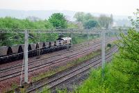 An empty 66 hauled train draws to a stop in the loops at Arkleston Junction, ready to be overtaken, just east of Paisley Gilmour Street. Tree growth now covers the former Renfrew line to the right and abortive line to Barrhead to the left.<br><br>[Ewan Crawford&nbsp;10/05/2008]