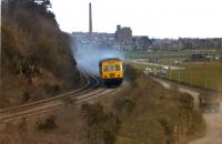 A class 101 Metro-Cammell 3 car DMU on a Dundee - Perth service in April 1979 is seen looking east from Riverside Drive as it approaches the site of Ninewells Jct. The junction which was on the Invergowrie side of the road bridge that takes Riverside Drive over the railway. With thanks to Bill Dryden for clarification of the location.<br><br>[John McIntyre&nbsp;/04/1979]