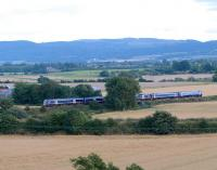Edinburgh - Perth evening commuter service near Hilton Junction on 28 August. The steading to left is Hilton Farm and the village over the train is Bridge of Earn.<br><br>[Brian Forbes&nbsp;28/08/2008]