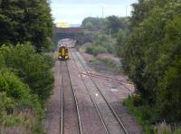 View east from the B792 Blackburn Road overbridge as a 158 approaches Bathgate on 28 August. The train is about to pass a set of points installed to provide access to the new STVA car terminal, a project that appears to have been <I>put on hold</I> for the time being.<br><br>[Bill Roberton&nbsp;28/08/2008]