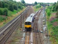 A Colne service with 150148 leaves the Up Slow line at Farington Curve Junction to climb the bank before heading east. At this point Ormskirk trains take the additional crossing to gain the former main line to Liverpool. <br><br>[Mark Bartlett&nbsp;16/08/2008]