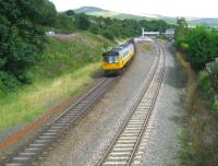 142047 in Merseyrail livery but with Northern Rail logo as well (must be the Serco NedRail connection!) slows for the stop at Chinley station on a Manchester - Sheffield stopping service on 23 August 2008.<br> <br><br>[John McIntyre&nbsp;23/08/2008]
