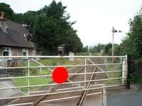 Although the Windermere branch is now operated as a <I>one engine in steam</I> siding the level crossing near Burneside station is still protected by two semaphores. View towards Burneside station, which is just round the corner, and Windermere. <br><br>[Mark Bartlett&nbsp;30/08/2008]