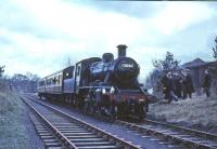 BR Standard class 2 2-6-0 no 78046 with the 1965 <I>Scottish Rambler no 4</I> railtour on 19 April 1965. The photograph is thought to have been taken at Currie, with the old goods shed standing in the background [see image 3300].<br><br>[G W Robin&nbsp;19/04/1965]