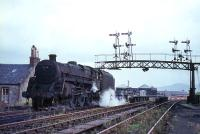 View of Princes Pier station framed in the gantry of GSWR signals in August 1965 as 73104 awaits the arrival of its train.<br><br>[G W Robin&nbsp;25/08/1965]