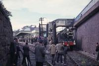 J37 No 64569 meets a photographic scrum at the south end of St Andrews station during the 1965 RCTS <I>Fife Coast railtour</I>. The J37 had taken over from No 256 <I>Glen Douglas</I> at Leuchars Junction and took the train round the Fife Coast line before handing back to no 256 at Thornton Junction.<br><br>[G W Robin&nbsp;28/08/1965]