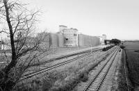 View south along the Hopeman branch towards Alves Junction in the early 1980s with Roseisle Maltings on the left. A new �40m malt whisky distillery is scheduled to open near here in 2009. Utilisation of the former branch rail network is being considered by Diageo to serve these locations as well as their facility at Cameron Bridge.<br><br>[Bill Roberton&nbsp;//]