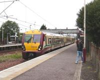 334 031 forming a Gourock - Glasgow Central service at Hillington West on 30 August. <br><br>[David Panton&nbsp;30/08/2008]