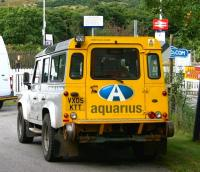 An Aquarius roadrail vehicle stands at the level crossing at the east end of Rogart station on 28 August 2007 awaiting the passage of the 0714 from Inverness to Wick & Thurso. Once the train is clear, the vehicle will mount the rails on the crossing and undertake a PW inspection trip as far as Kildonan.  <br><br>[John Furnevel&nbsp;28/08/2007]
