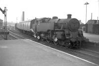 Standard 2-6-4T 80107 shunts the north side parcels/goods platform at the west end of Paisley Gilmour Street in July 1963, with Stoneybrae signal box visible in the left background.<br><br>[Colin Miller&nbsp;10/07/1963]