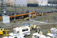The aftermath of the Bellgrove crash in 1989. Two 303s met in a head on collision on the single lead from Bellgrove Junction. One driver and one passenger were killed. The Springburn bound train is to the left and that from Springburn underneath and to the right. The Airdrie line is in the foreground. [See image 33386]<br><br>[Ewan Crawford&nbsp;06/03/1989]