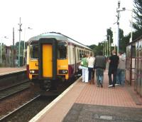 Saturday shoppers prepare to board a Whifflet - Glasgow Central train at Kirkwood on 30 August 2008, formed by DMU 156 433 <I>The Kilmarnock Edition</I>.  <br><br>[David Panton&nbsp;30/08/2008]