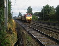 Travelling on the Up Slow line at Euxton on 6 September is 67027 with an <I>Orient Express - Northern Belle</I> charter.<br><br>[John McIntyre&nbsp;06/09/2008]