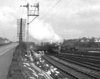 Two Black 5s emerge westbound from under the Arkleston Road Bridge, where they had been held at signals. The train nearest the camera is heading for Gourock while the other is on the Ayr line. At this time (Autumn 1966) there were 12 tracks at this point - up/down Renfrew, up/down Gourock, up/down Ayr, 2 down goods loops and 4 engineers sidings.<br><br>[Colin Miller&nbsp;//1966]