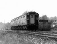 A Weymouth to Bournemouth push-pull service, comprised of a class 33 locomotive attached at the rear of a pair of 4TC sets, photographed at speed near Wareham in May 1977.<br><br>[John McIntyre&nbsp;20/05/1977]
