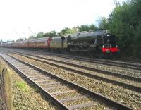 Ex-LMS <I>Royal Scot</I> 4-6-0 no 46115<I> Scots Guardsman</I> heads south on the Up Fast line at Euxton on 6 September 2008 with the outward leg of <I>The Lune Habitat</I> special from Carnforth to Chester (via Hellifield & Blackburn). The train had been held at Farington Junction due to a late running TPE service to Manchester Airport and the driver was obviously trying to make up time!<br> <br><br>[John McIntyre&nbsp;06/09/2008]