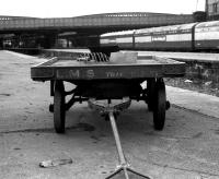 25 years after the LMS became part of the nationalised British Railways, a platform trolley still bearing the initials of the former company stands at platform 11 at the north end of Aberdeen station on 23 April 1973.<br><br>[John McIntyre&nbsp;23/04/1973]