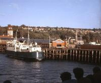 Passing Wemyss Bay on a Clyde steamer on 31 May 1969 with the ferry <I>Arran</I> at the pier. In the centre is the entrance to the covered walkway leading up to the station concourse. The steamer was on a special excursion from Greenock calling at Gourock (where I joined), Kilmun, Dunoon, then through the Kyles of Bute to Brodick before returning via Ardrossan. <br> <br><br>[John McIntyre&nbsp;31/05/1969]
