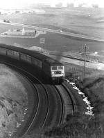 A class 47 hauls a southbound service out of Aberdeen past Nigg Bay in April 1979.<br> <br><br>[John McIntyre&nbsp;11/04/1979]