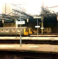 <I>Rationalisation work</I> underway at Newcastle Central on 8 March 1980, with BRC&W Class 104s E50565 & E50556 standing in the east end bay platforms waiting to depart on North Tyneside services. This area is now a car park.�<br> <br><br>[Colin Alexander&nbsp;08/03/1980]