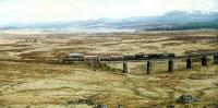 A northbound freight crosses Rannoch Viaduct. In the background to the left is Schiehallion.<br><br>[Ewan Crawford&nbsp;//1990]