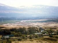 A northbound freight approaches Rannoch station over the wastes of Rannoch Moor. Note the camping coach bottom left. There was a siding here with a turntable (the pit it just to the right of the coach).<br><br>[Ewan Crawford&nbsp;//1990]