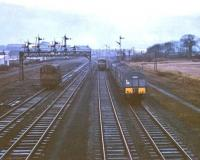 Last day of passenger services at Grangemouth on Saturday 27 January 1968. View is south towards Fouldubs Junction, with Grangemouth station behind the camera. A diesel shunter stands on the freight lines to the left while the branch railbus (W79978), which latterly handled traffic on the Grangemouth - Falkirk - Larbert - Alloa (via the swing bridge) route is seen heading for Grahamston. On the right is a <I>last day special</I> DMU showing Gourock on the destination blind.<br><br>[Bruce McCartney&nbsp;27/01/1968]